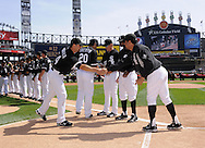 CHICAGO - APRIL 5:  Manager Ozzie Guillen #13 greets Paul Konerko #14 of the Chicago White Sox during Opening Day ceremonies prior to the game against the Cleveland Indians on April 5, 2010 at U.S. Cellular Field in Chicago, Illinois.  The White Sox defeated the Indians 6-0.  (Photo by Ron Vesely)
