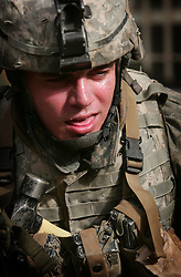 A heavily laden US soldier feels the effects of 120 degree temperatures and body armor in Ahdamiyah - a largely Sunni district in central Baghdad - on the first morning of a large-scale security sweep by US and Iraqi soldiers and police on Sunday August 27, 2006. The sweep is being led by the 172nd Stryker Brigade based in Fairbanks, Alaska. The 172nd was extended at the last moment - with portions of the brigade already back in the States - when they were called upon to bolster security forces in Baghdad seeking to get a handle on a massive wave of sectarian killings in the Iraqi capital.