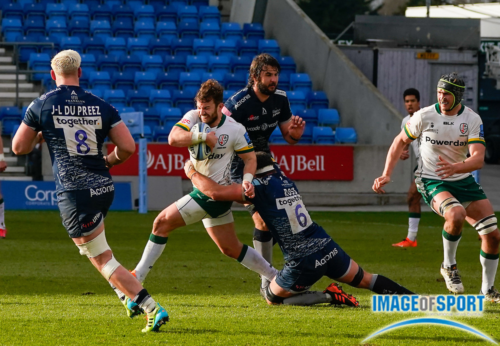 London Irish Fullback James Stokes is held by Sale Sharks flanker Jono Ross during a Gallagher Premiership Round 14 Rugby Union match, Sunday, Mar 21, 2021, in Eccles, United Kingdom. (Steve Flynn/Image of Sport)