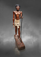 Ancient Egyptian wooden statue of Wepwawetemhat, Middle Kingdom, 12th Dynasty, (1939-1875 BC), Asyut, Tomb of Minhotep. Egyptian Museum, Turin. Cat 8786. Grey background. .<br /> <br /> If you prefer to buy from our ALAMY PHOTO LIBRARY  Collection visit : https://www.alamy.com/portfolio/paul-williams-funkystock/ancient-egyptian-art-artefacts.html  . Type -   Turin   - into the LOWER SEARCH WITHIN GALLERY box. Refine search by adding background colour, subject etc<br /> <br /> Visit our ANCIENT WORLD PHOTO COLLECTIONS for more photos to download or buy as wall art prints https://funkystock.photoshelter.com/gallery-collection/Ancient-World-Art-Antiquities-Historic-Sites-Pictures-Images-of/C00006u26yqSkDOM