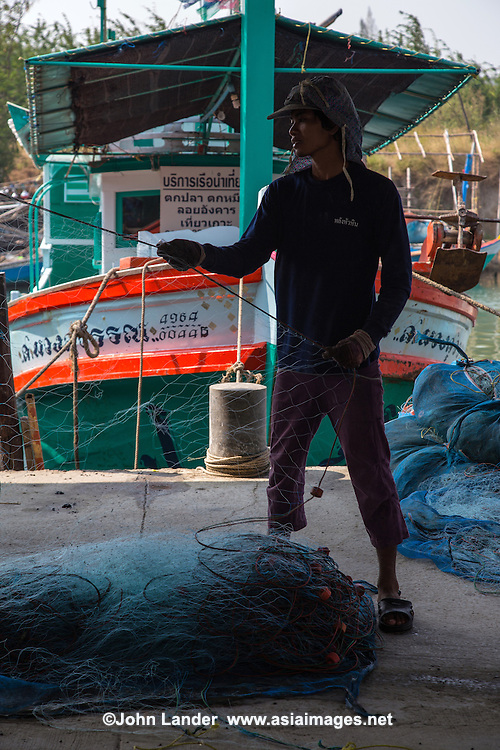 Hua Hin Fisherman - Hua Hin Sea Market Thailand is lucky to have many beautiful seaside cities with an abundance of fresh seafood, and Hua Hin is certainly one of htem. , once a funky and lowly collection or ramshakle huts under Khao Takiab Hill, the Sea Market is THE source for lovers of the freshest seafood.  Still retaining s a touch of local life, fishermen next door to their family fish shops repairing nets, you know this is the real thing.  Originally most fish shops sold by the kilo, but nowadays they will cook up whatever you buy from them,  thus explaining its popularity.  In season, you will find crabs, shrimp, prawns, squid, snapper, mollosks and just about any fish that swims in the Gulf of Thailand