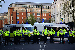 © Licensed to London News Pictures. 20/04/2021. London, UK. A heavy police presence as Fans celebrate outside Stamford Bridge in West London after it was announced the club would be applying to withdraw from the European Super League. There has been widespread hostility towards proposals for a new elite league of European football clubs, which opponents say will kill competition and damage the sport. Photo credit: Ben Cawthra/LNP
