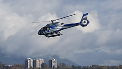November 2, 2018 - Richmond, British Columbia, Canada - A Eurocopter EC130 T2 helicopter (N1958M), registered to MJB Investments LLC, takes off from Vancouver International Airport. (Credit Image: © Bayne Stanley/ZUMA Wire)
