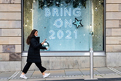 Edinburgh, Scotland, UK. 14 November 2020. Views of Edinburgh city centre on Saturday afternoon during a level 3 lockdown imposed by the Scottish Government.Pictured; Shop window display in Harvey Nichols store. Iain Masterton/Alamy Live News.