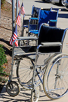 Wheelchairs wait for their occupants at the base of a hill during Sunday's ceremony honoring fallen heroes at the Monterey County Vietnam Veterans Memorial in Salinas.