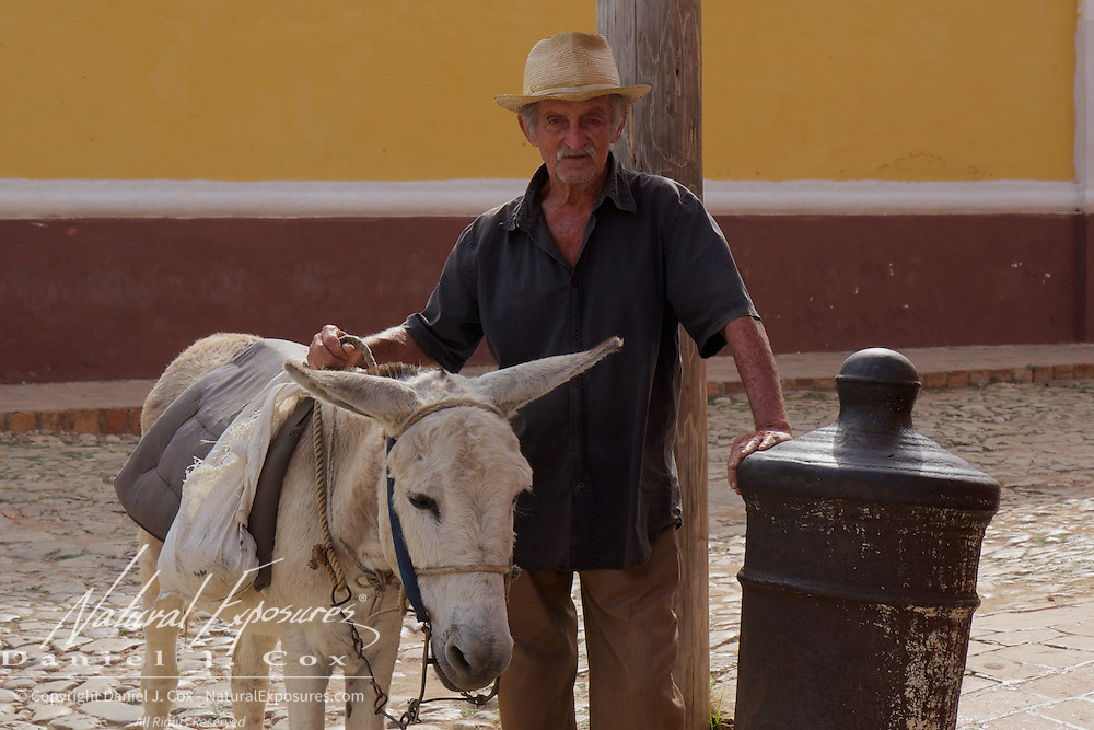 An older gentleman with his donkey on the street in Trinidad, Cuba.