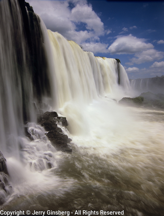 South America, Brazil, Igwazu Falls. Igwacu Falls drops gloriously in to the river below.