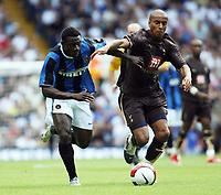Photo: Chris Ratcliffe.<br /> Tottenham Hotspur v Inter Milan. Pre Season Friendly. 28/07/2006.<br /> Benoit Assou-Ekotto of Spurs (L) clashes with Obafemi Martins of Inter.