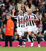 Photo: Mark Stephenson.<br /> West Bromwich Albion v Queens Park Rangers. Coca Cola Championship. 30/09/2007.West Brom's Ishmael Miller (B) celebrates his goal with Kevin Phillips (F) and Paul Robinson (R)