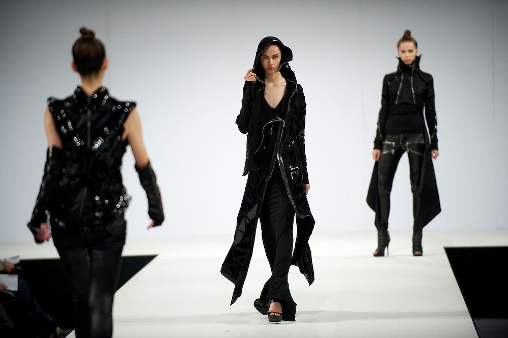 Models saunter down the catwalk at a fashion show during Graduate Fashion Week in Earl's Court, London.
