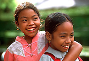 INDONESIA, BALI, VILLAGE LIFE portrait of two young girls in a rural  Balinese village