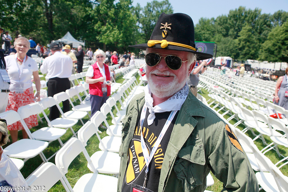 Terrance Young, who served in the Blues platoon of Bravo Troop, 1st Squadron, 9th Cavalry, 1st Cavalry Division stands in the seating area before the United States of America Vietnam War Commemoration National Announcement and Proclamation Ceremony at the Vietnam Veterans Memorial Wall.