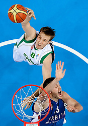 Matjaz Smodis of Slovenia vs Kosta Perovic of Serbia during basketball game between National basketball teams of Slovenia and Serbia in 7th place game of FIBA Europe Eurobasket Lithuania 2011, on September 17, 2011, in Arena Zalgirio, Kaunas, Lithuania. Slovenia defeated Serbia 72 - 68 and placed 7th. (Photo by Vid Ponikvar / Sportida)
