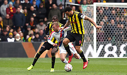 Watford's Troy Deeney (right) and Crystal Palace's Max Meyer battle for the ball during the FA Cup quarter final match at Vicarage Road, Watford.