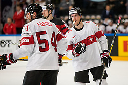 Philippe Furrer of Switzerland and Gaetan Haas of Switzerland during the 2017 IIHF Men's World Championship group B Ice hockey match between National Teams of Canada and Switzerland, on May 13, 2017 in AccorHotels Arena in Paris, France. Photo by Vid Ponikvar / Sportida