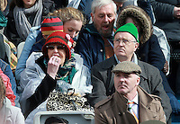 A couple have a bit of lunch as they watch  the 1916 Easter Rising Commemoration Parade on Dublin's O Connell St. Picture Credit: Frank Mc Grath<br /> 27/3/16
