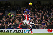 Antonio Rudiger  of Chelsea and Saido Berahino of Stoke city battle for the ball .<br /> Premier league match, Chelsea v Stoke city at Stamford Bridge in London on Saturday 30th December 2017.<br /> pic by Kieran Clarke, Andrew Orchard sports photography.