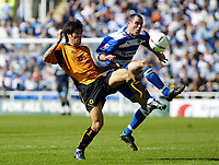 Photo. Chris Ratcliffe<br /> Reading v Wolverhampton Wanderers. Coca Cola Championship. 30/04/2005<br /> Ki-Hyeon Seol of Wolves tussles for the ball with Andy Hughes of Reading