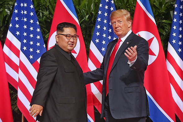 Jun 11, 2018 - Singapore - Top leader of the Democratic People's Republic of Korea (DPRK) KIM JONG UN (L) meets with U.S. President DONALD TRUMP in Singapore before the first-ever DPRK-U.S. summit. Expanded Bilateral Meeting between President of the United States of America Donald Trump and Chairman of the State Affairs Commission of the Democratic People's Republic of Korea Kim Jong Un at Capella, Singapore. (Credit Image: © Kevin Lim/The Straits Times via ZUMA Wire)