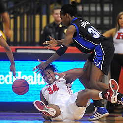 Rutgers Scarlet Knights forward/center Monique Oliver (34) falls to the floor while battling Seton Hall Pirates center Tajay Ashmeade (33) for a rebound during second half NCAA Women's Basketball action between the Rutgers Scarlet Knights and Seton Hall Pirates at the Louis Brown Athletic Center. Rutgers defeated Seton Hall 62-39.
