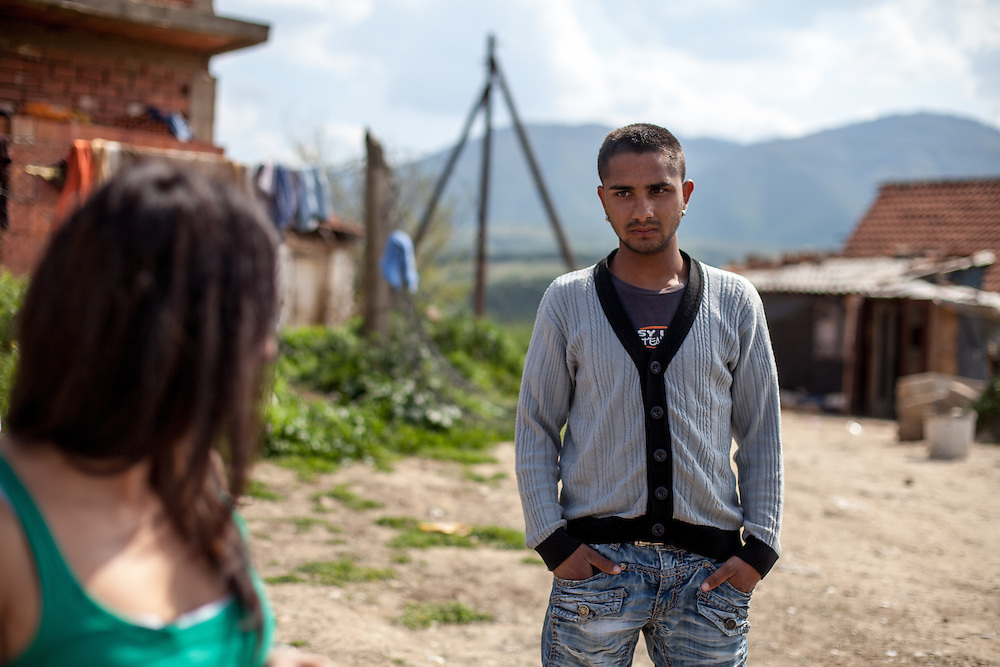 Romina Kajtazova - working as a paralegal for NGO Kham - talking to a young man from the local Roma community during the European Immunization Week in the city of Vinica in Macedonia.