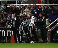 Photo: Andrew Unwin.<br /> Newcastle United v Celta Vigo. UEFA Cup. 23/11/2006.<br /> Newcastle's Glenn Roeder (L) looks away as Albert Luque (R of C) receives treatment.