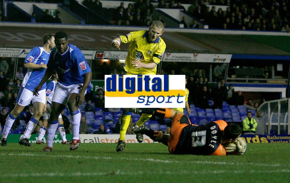 Birmingham keeper Colin Doyle gathers under pressure from Leeds Kevin Nicholls (18)