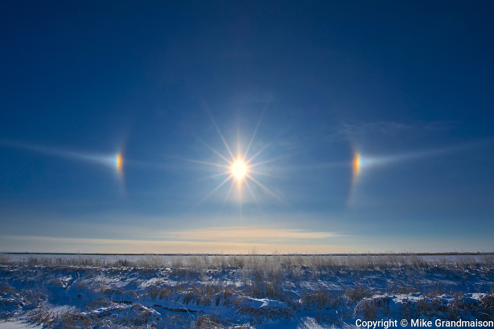 Sundogs and prairie landscape<br />Lorette<br />Manitoba<br />Canada