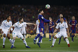 May 6, 2018 - Barcelona, Catalonia, Spain - May 6, 2018 - Camp Nou, Barcelona, Spain - LaLiga Santander- FC Barcelona v Real Madrid CF; Leo Messi of FC Barcelona kicks the ball with the heath. (Credit Image: © Marc Dominguez via ZUMA Wire)