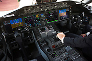 Boeing pilot sits in glass cockpit of the 787 Dreamliner (N787BX) at the Farnborough Airshow. On its first flight outside of the US during its testing programme, the newest airliner in the Boeing aviation family, has arrived at the air show for a few days of exhibitions to the aerospace-buying community and the trade press. Later the public will have the chance to see this jet up close too. The Boeing 787 Dreamliner is a long range, mid-sized, wide-body, twin-engine  jet airliner developed by Boeing Commercial Airplanes. It seats 210 to 330 passengers, depending on variant. Boeing states that it is the company's most fuel-efficient airliner and the world's first major airliner to use composite materials for most of its construction