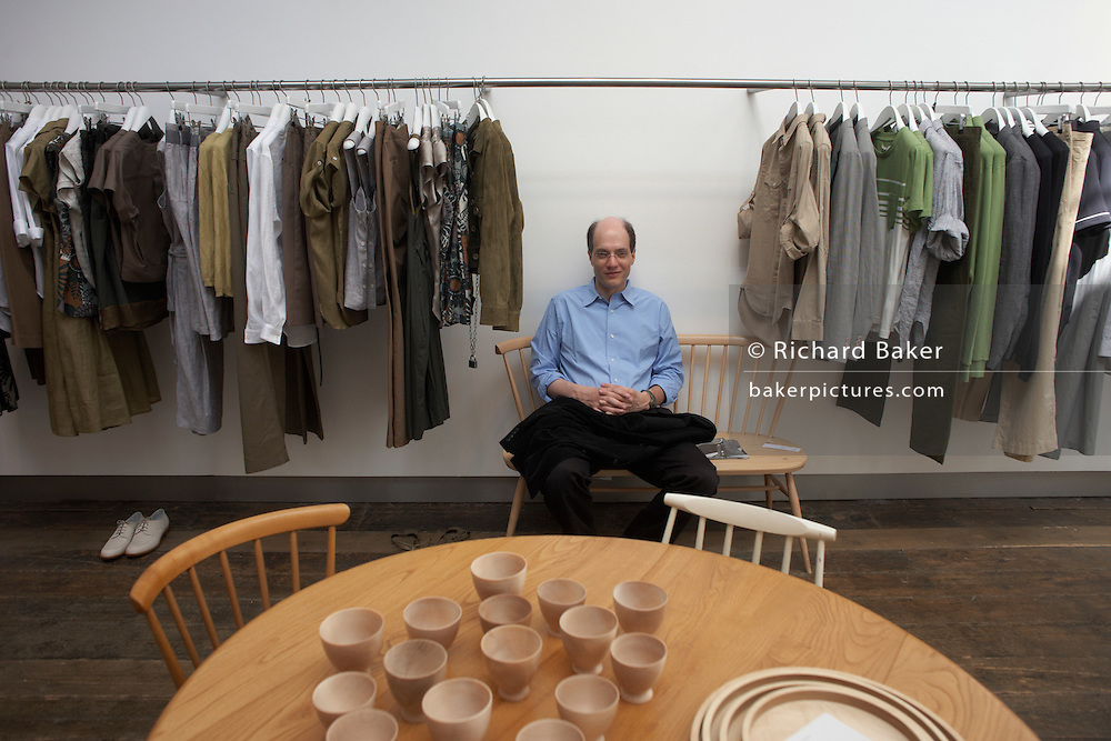 Writer Alain de Botton sits in couturier Margaret Howell's retail flagship and design studio in Wigmore Street, London while researching his book, The Pleasures and Sorrows of Work (Hamish Hamilton, UK 2009)