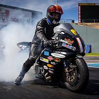Brett Ghedina (2133) warms the rear tyre on his Honda CBR Competition Bike.