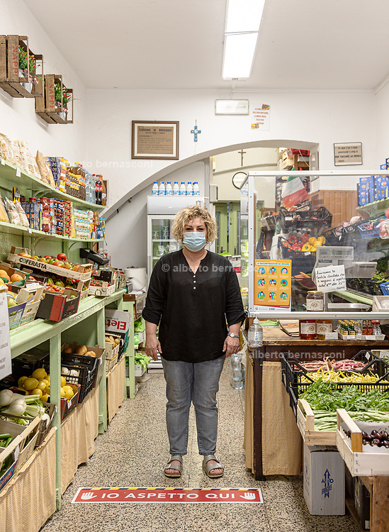 Bergamo: the  upper town is almost, usually packed with tourists from all around the world is almost empty. Denicola Annalisa in her fruit shop. it's open only in the morning, without tourists makes no sense to keep it open in the afternoon. she use to work more during the lockdown delivering fruits and vegetables .