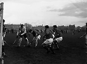 16/01/1960<br /> 01/16/1960<br /> 16 January 1960<br /> Interprovincial Mens Hockey: Munster v Leinster. A dangerous moment for the Munster defence as leinster forwards (on right) crowd into the goalmouth during the match at Londonbridge Road, Dublin. Munster keeper D. O'Riain (right) cleared the ball safely.