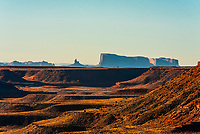 The Monument Valley in the distance seen from Goosenecks State Park, near Mexican Hat, Utah USA.