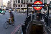On the first day of the government's second national Coronavirus lockdown, a cyclist passes an entrance to Monument underground station in the capital's financial district, the Square Mile, on 5th November 2020, in London, England. Although most workers are still working from home, the continuing pandemic restrictions are damaging small buinesses anf the wider UK economy. The current lockdown is to last at least 4 weeks in the run-up to Christmas.