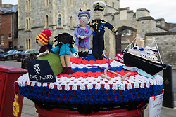 A knitted postbox topper prepared by Ickenham Postbox Toppers and featuring the Queen and Duke of Edinburgh, the royal yacht Britannia and some Duke of Edinburgh award students is pictured in front of Windsor Castle on 16th April 2021 in Windsor, United Kingdom. The funeral of Prince Philip, Queen Elizabeth II's husband, will take place at St George's Chapel in Windsor Castle at 15:00 BST on 17th April, with the ceremony restricted to 30 mourners in accordance with current coronavirus restrictions.