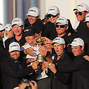 Ryder Cup 2016. Day Three. The United States team with the Ryder Cup after the United States victory in the Ryder Cup tournament at Hazeltine National Golf Club on October 02, 2016 in Chaska, Minnesota.  (Photo by Tim Clayton/Corbis via Getty Images)