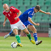 Hungary's Jozsef Varga (L) and Israel's Maor Melicsohn (R) fight for the ball during a friendly football match Hungary playing against Israel in Budapest, Hungary on August 15, 2012. ATTILA VOLGYI