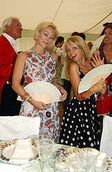 Left to right, ELLIE SHEPHERD and HANNAH SANDLING at the Cartier International polo at Guards Polo Club, Windsor Great Park, on 30th July 2006.<br />