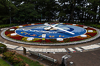"""Toi Flower Clock is inside of Matsubara Park in Toi, Izu.  The clock was completed in 1991 and recognized as the world's largest flower clock in the Guinness Book of World Records in March 1992. The clock is  31m in diameter, and is decorated with about  5,000 flowers. Surrounding the clock, on its periphery, there is a so-called """"healthy sidewalk"""" where stones that stimulate the soles of ones feet.  This is a form of Chinese stone acupressure  As colorful and unusual as the clock is, it is rarely reset with the ccorrect time."""