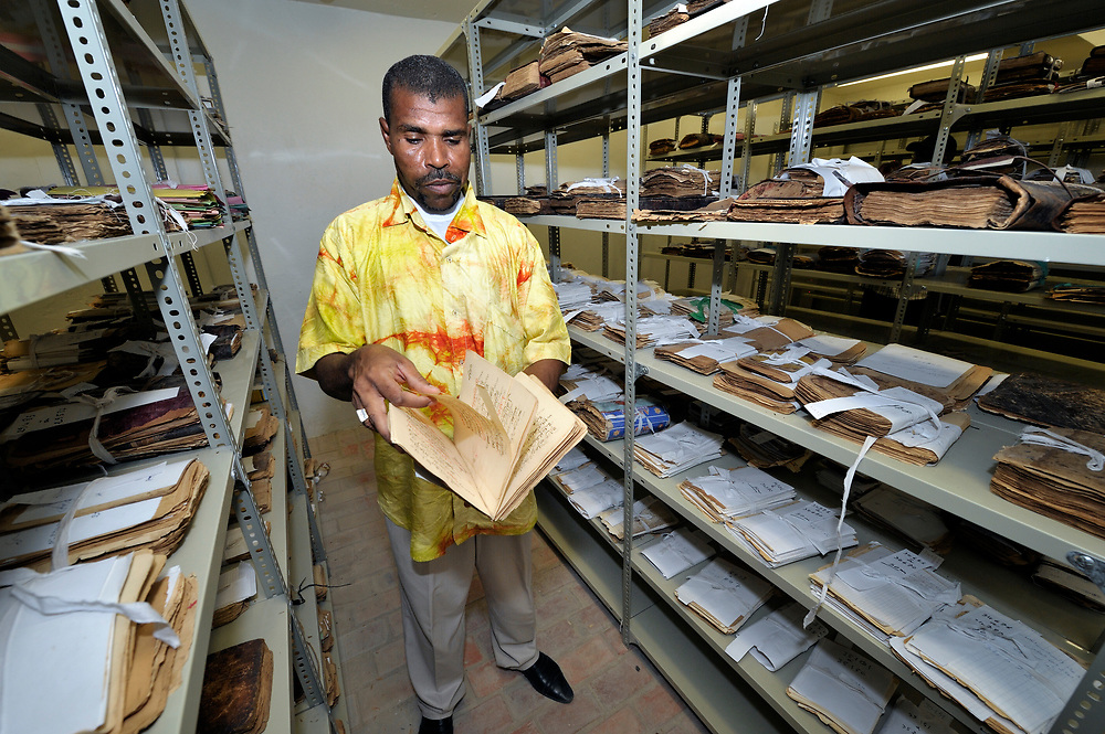 Abdoulaye Cisse, the interim director of the Ahmed Baba Institute in Timbuktu, Mali, inspects ancient Islamic manuscripts that went undetected by militant Islamists, who seized control of the city in 2012, and destroyed any such documents they could find. The city was liberated by French and Malian soldiers in early 2013. Most of the city's thousands of ancient manuscripts were smuggled out of the region under the nose of the jihadis.