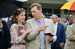 DARCEY BUSSELL and her husband ANGUS FORBES at day 3 of the Qatar Glorious Goodwood Festival at Goodwood Racecourse, Chechester, West Sussex on 28th July 2016.