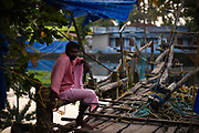 A fisherman working with traditional chinese fishingnets in Kerala province, India
