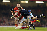 Luke Charteris of Wales is tackled by Jonny Gray of Scotland. RBS Six nations championship 2016, Wales v Scotland at the Principality Stadium in Cardiff, South Wales on Saturday 13th February 2016. <br /> pic by  Andrew Orchard, Andrew Orchard sports photography.