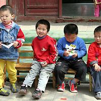Asia, China, Beijing. Chinese kindergarten children in Hutongs of Beijing.