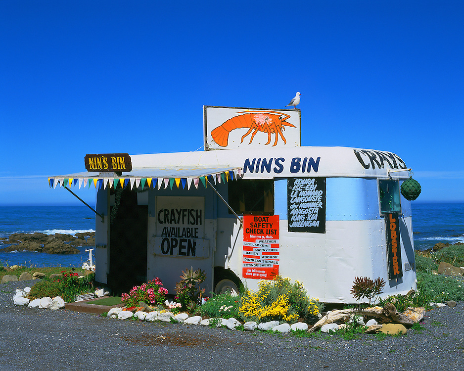 Sea food shack-trailer-caravan displays vivid colors on the Kaikoura Coast on the east coast of the South Island of New Zealand.
