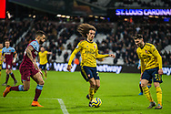 Ryan Fredericks (West Ham) & Sead Kolasinac (Arsenal) either side of Matteo Guendouzi (Arsenal) with the ball during the Premier League match between West Ham United and Arsenal at the London Stadium, London, England on 9 December 2019.