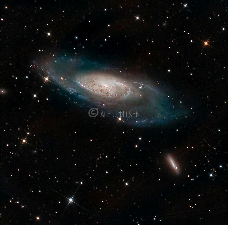 Messier 106 in constellation Canes Venatici at a distance about 23 million LY from Earth.  The smaller galaxy is NGC 4248, a dwarf galaxy member of the same galaxy group as M106.