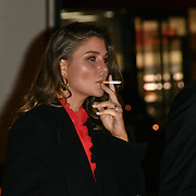 A lady smoking outside DKMS is the world's largest international donor centre. So far they have helped to register over 8 million potential donors and facilitated over 70,000 blood stem cell transplants worldwide Big Love London Gala at The Round House on 7 November 2018, London, UK.